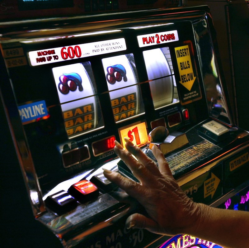 Jane Ferencz of East Lyme, CT works a slot machine at Mohegan Sun in Uncasville, CT. Mohegan Sun on Monday unveiled renderings of its new, more elaborate plans for a casino in the rural Western Massachusetts town of Palmer. Castaway children Fred J. Field gambling