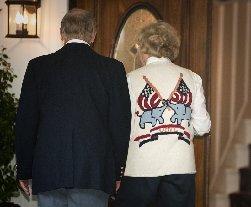 Attendees, including one wearing a Republican-themed sweater, walk into a private fundraiser for Gov. Paul LePage at the Nonantum Resort in Kennebunkport on Tuesday.
