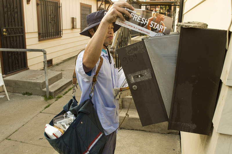 A U.S. mail carrier delivers mail in Los Angeles. The financially struggling U.S. Postal Service may consider phasing out door-to-door delivery.