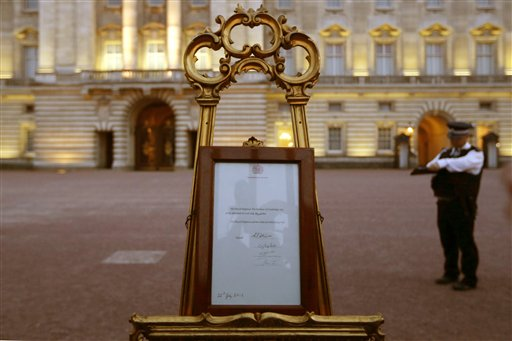 A notice proclaiming the birth of a baby boy to Prince William and Catherine, Duchess of Cambridge is displayed for public view at Buckingham Palace in London on Monday.