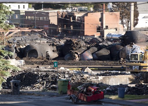 Charred tanker cars from the train crash scene remain in Lac-Megantic, Quebec, on Friday. Transportation workers moved carefully Friday in and around the site of the nearly week-old derailment that incinerated the heart of this small Quebec town and killed 50 people, searching for evidence that would help explain what led to such massive destruction.
