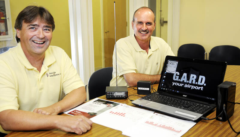 Ron Cote, left, and John Guimond have built a device that records radio traffic for use at airports.