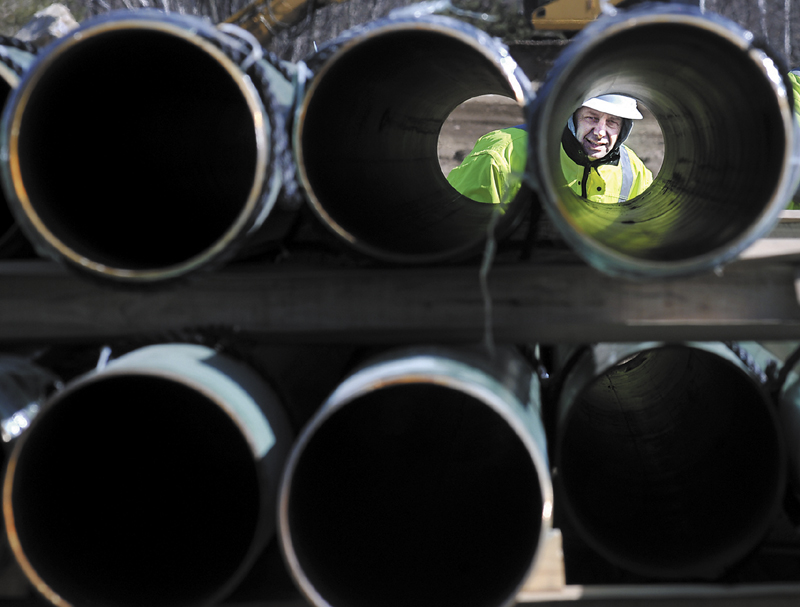 Rick Bellemare inspects a steel pipe delivered to the Windsor laydown yard of Maine Natural Gas earlier this year. The firm has reached an agreement with the University of Maine at Augusta to provide the school with natural gas for five years.