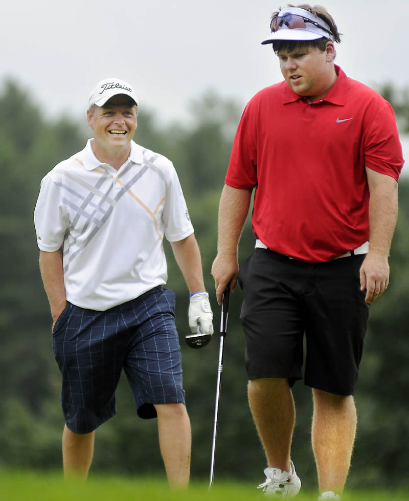 The winner smiles: Ricky Jones, left, shares a laugh with Ryan Gay on Thursday during the final round of the Maine Amateur championship at the Augusta Country Club in Manchester. Jones shot 6-under par for the tournament to win his third title. Gay finished tied for fourth.