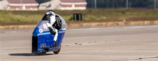 Bill Warner makes a run on his motorcycle during The Maine Event on a runway at a former air base Sunday, July 14 2013, at Limestone, Maine. Warner, 44, of Wimauma, Fla., died Sunday after losing control and zooming off a runway on a later run.