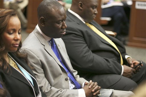Attorneys Natalie Jackson, Benjamin Crump and Daryl Parks, from left, sit in for the Trayvon Martin family during George Zimmerman's trial in Seminole Circuit Court in Sanford, Fla. today.
