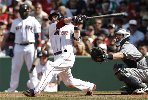 Boston Red Sox's Dustin Pedroia follows through on a hit Thursday against the San Diego Padres at Fenway Park in Boston. The Red Sox won 8-2.