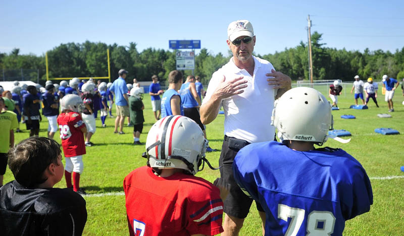 WORDS FROM A PRO: Former New England Patriots' quarterback Steve Grogan talks to campers during the Central Maine Football Camp on Saturday at Bill Donahue Field in the Richard McGee Athletic Complex in Fairfield.