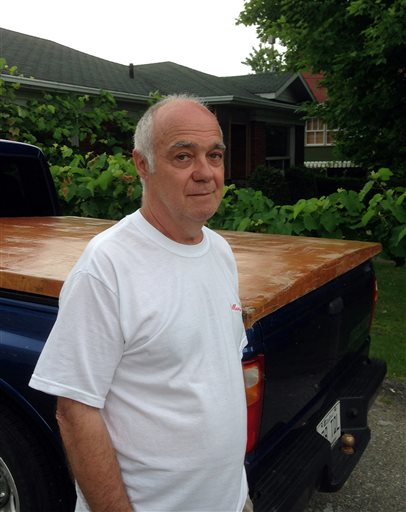 Gilles Fluet poses for a photo outside his home in Lac-Megantic, Quebec, on Wednesday. Fluet was in the Music-Cafe pub early July 6, but left moments before it was destroyed by a runaway oil train.