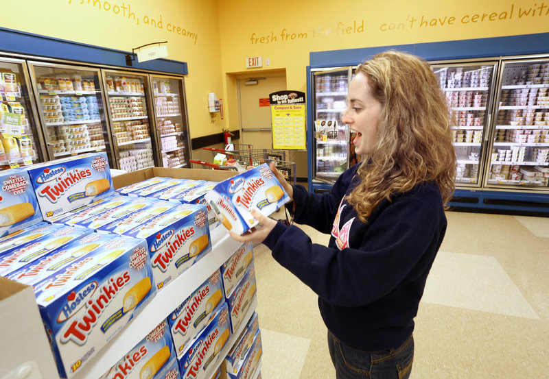 Twinkies have returned to Hannaford in Portland where they will be officially for sale starting Monday. Emily Strumpf of Portland is excited to see the spungy, yellow cakes made by Hostess on Wednesday, July 10, 2013.