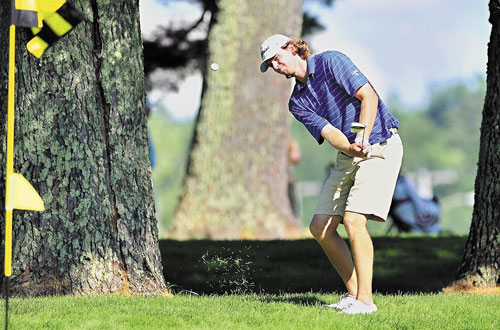 WINNER: Evan Harmeling chips onto a green on the back nine during the Charlie's Maine Open on Tuesday at Augusta Country Club in Manchester. Harmeling shot a two-day total of 133 to win.