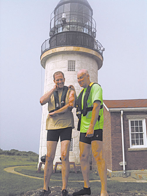 Dan Benson, left, and David Grody share a sense of relief on June 30 shortly after crashing their boat on Seguin Island three miles from Popham Beach.
