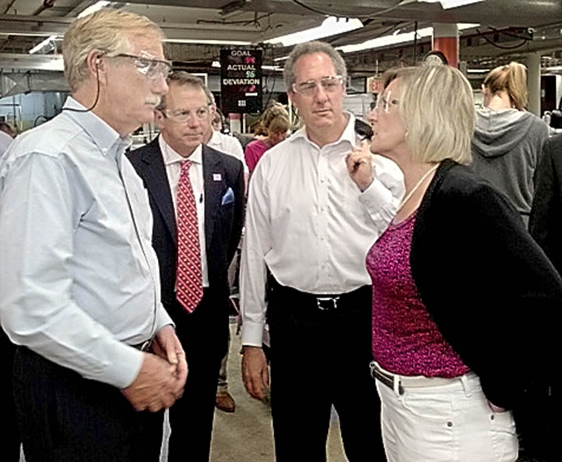 U.S. Trade Representative Michael Froman, second from right, listens as New Balance Plant Manager Raye Wentworth, right, leads a tour of the Norridgewock plant today. U.S. Sen. Angus King, left, and New Balance CEO Rob DeMartini listen.