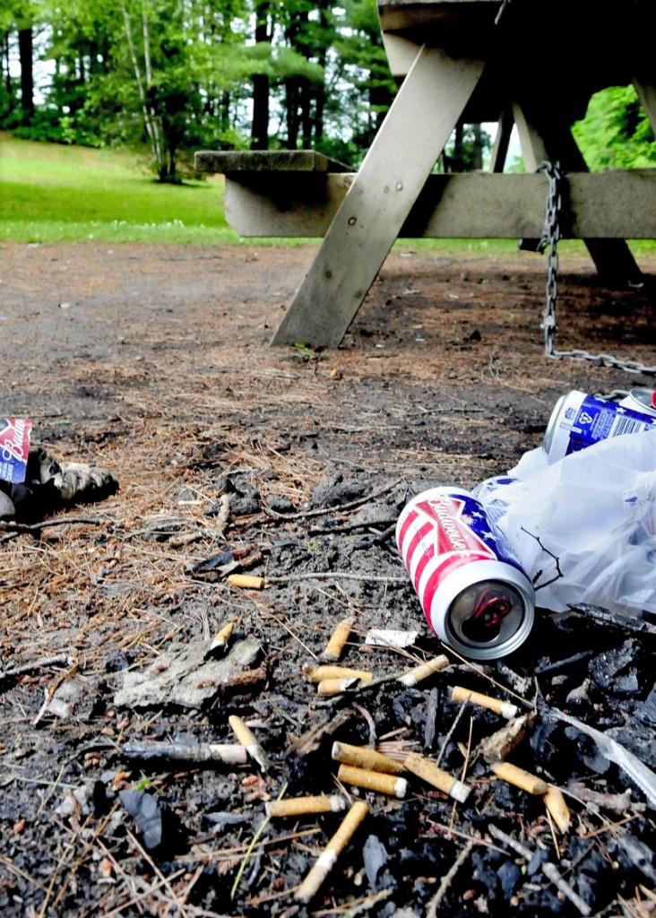 Cigarette butts and other trash left at one of the picnic sites at the Pleasant Point Park in Oakland on Monday.