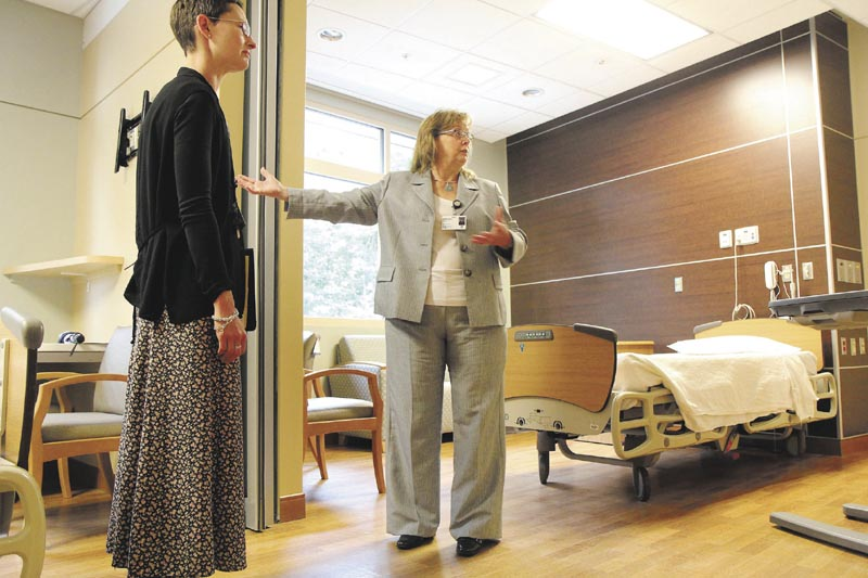 Sebasticook Valley Health acting President and CEO Terri Vieira, center, describes the amenities of a double occupancy room, called a super suite, in the hospital's new inpatient wing in Pittsfield on Wednesday. Looking on is Sebasticook Valley Health Marketing Manager Jennifer Yarbrough, left.