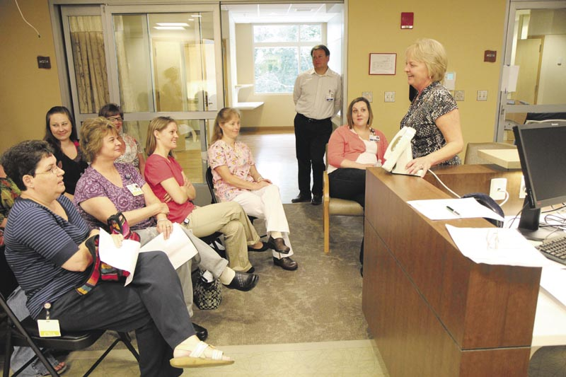 Pam Cobill of Signet Electronics Systems, right, conducts an orientation session on the new calling system inside Sebasticook Valley Hospital's new inpatient wing in Pittsfield on Wednesday.