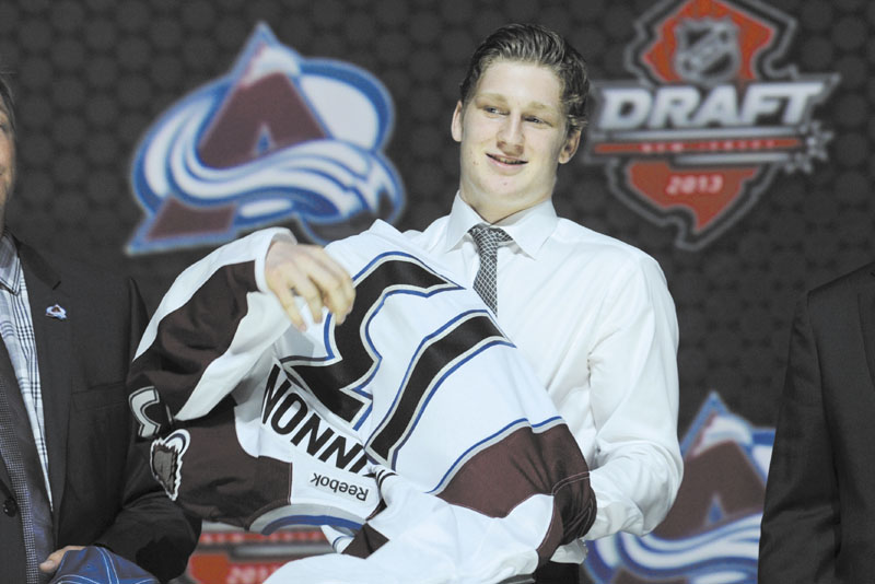 COLORADO'S NEW STAR: Nathan MacKinnon grew up in the same hometown as Sidney Crosby and grew up idolizing the Penguins star. Now, like his boyhood hero, MacKinnon is a No. 1 pick in the NHL draft.