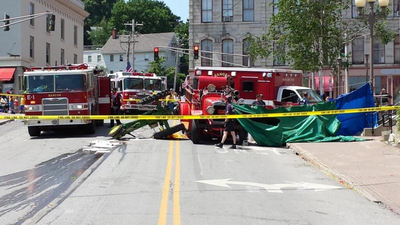 The scene on Water Street in Bangor on Thursday following an accident that killed a man riding a tractor in the July Fourth parade. (Photo courtesy WABITV.)