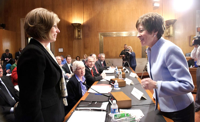 Sen. Susan Collins, R-Maine, talks with Hermon resident Kim Nichols, left, before a March hearing of the Senate Special Committee on Aging about lottery scams targeting senior citizens. Nichols' father, who lives in New Hampshire, lost $85,000 to the Jamaica-based scammers.