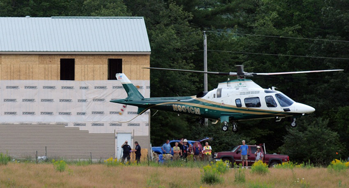 A LifeFlight of Maine helicopter lifts off today with a patient from a building site, between Pleasant Pond Farm Lane and U.S. Route 201 in Richmond, after two carpenters were injured in a fall.