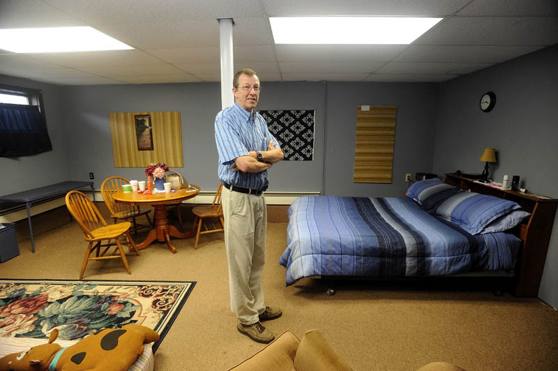 Steve Bracy, pastor of Living Waters Assembley of God Church and vice president of Western Maine Homeless Outreach, stands in the only private room at his church. An initiative to renovate the basement of his 547 Wilton Road church in Farmington, to help handle the needs of the homeless in the area, has recently begun.