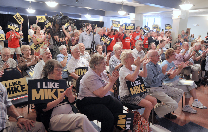 Supporters applaud during a news conference at which U.S. Rep. Mike Michaud announced his candidacy for governor at the Franco-American Heritage Center in Lewiston on Thursday.