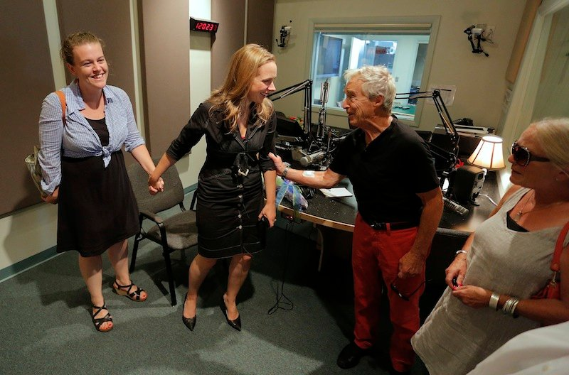 Suzanne Nance, center, in black, shares a moment with friends Kate Cox, at left, and Frank and Sharon Reilly, at right, after Nance signed off of her last broadcast as host of