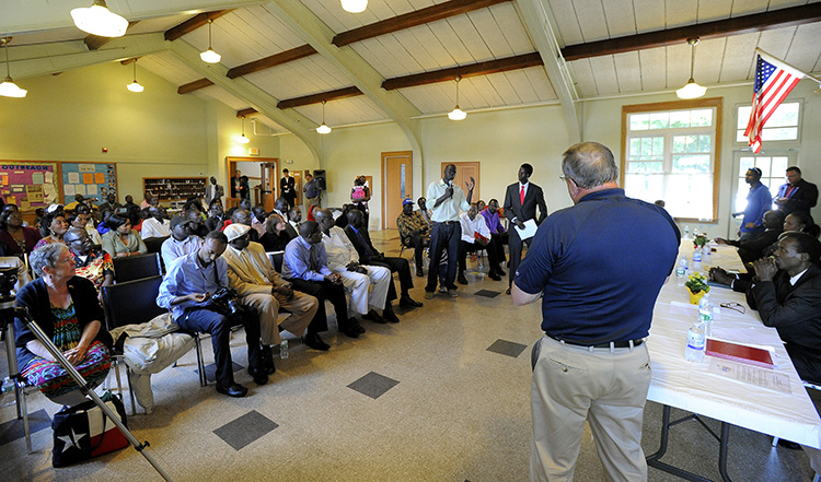 Gov. Paul LePage takes a question from Alfred Jacob as he visits members of the Sudanese community at Trinity Episcopal Church in Portland on Friday.