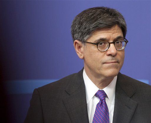 FILE - In this April 8, 2013, file photo U.S. Treasury Secretary Jacob Lew listens to a question during a media conference at EU headquarters in Brussels. Congress needs to raise the debt limit and take away the