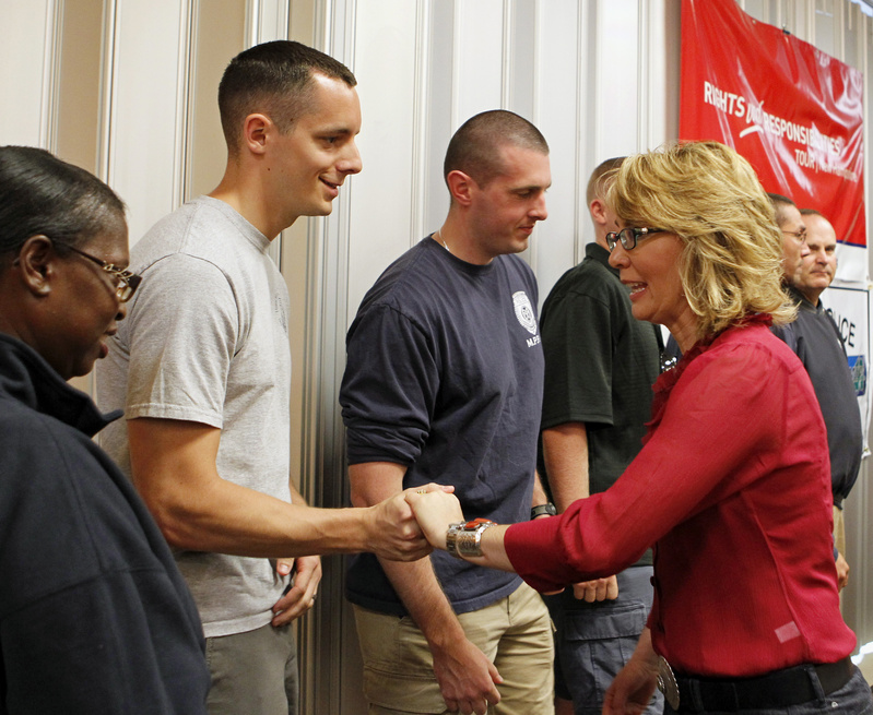 Former Arizona Rep. Gabrielle Giffords greets members of the Manchester, N.H., Police Patrolman Association last month. Three years after being shot in the head, Giffords is calling on New Hampshire's political leaders to have courage in the fight to expand background checks on gun purchases.