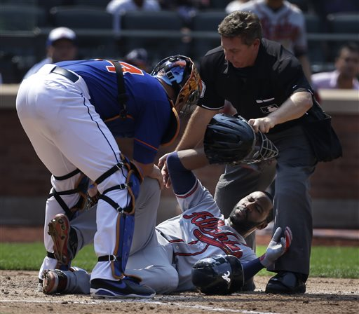 Atlanta Braves' Jason Heyward, center, is helped by New York Mets catcher John Buck, left, and umpire Greg Gibson after being hit by a 90 mph fastball thrown by New York Mets pitcher Jonathon Niese during the sixth inning of a baseball game at Citi Field, Wednesday in New York. Heyward was taken to the hospital for x-rays. (AP Photo/Seth Wenig)