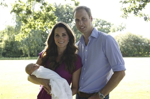 Another image taken by Michael Middleton, the Duchess's father, showing the Duke and Duchess of Cambridge with Prince George, in the garden of the Middleton family home in Bucklebury, England.