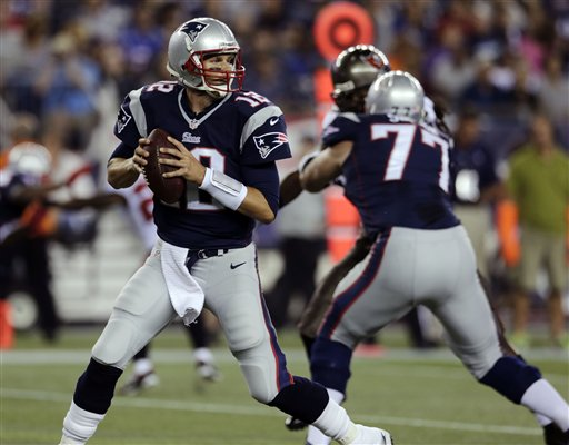 New England Patriots quarterback Tom Brady (12) looks to pass against theTampa Bay Buccaneers in the fist quarter of an NFL preseason football game Friday, Aug. 16, 2013, in Foxborough, Mass. (AP Photo/Charles Krupa)