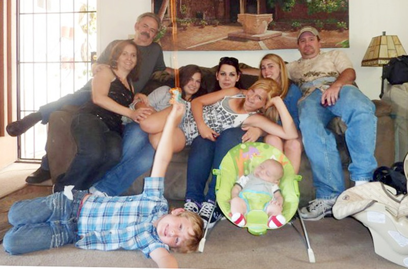 "In this June 2011 file photo provided by Andrea Saincome, Hannah Anderson, center, reclining across the laps of others, and James Lee DiMaggio, right, pose for a picture with other members of the extended Anderson and Saincome families. Via a social media site, Hannah Anderson says longtime family friend DiMaggio ""tricked"" her into visiting his house, tying up her mother and younger brother in his garage before escaping with her to the Idaho wilderness. Anderson says she cried all night after being rescued and learning that her family members were found dead at DiMaggio's burning house. Seated from left are: Christina Anderson; Christopher Saincome; Christina's sisters Samantha Saincome and Andrea Saincome; their niece Hannah Anderson, reclining; Alexi (last name unavailable, friend of Hannah's), and DiMaggio. On the floor are Ethan Anderson, left, and Andrea's infant child, whose name was not provided. (AP Photo/Courtesy of Andrea Saincome, File)"