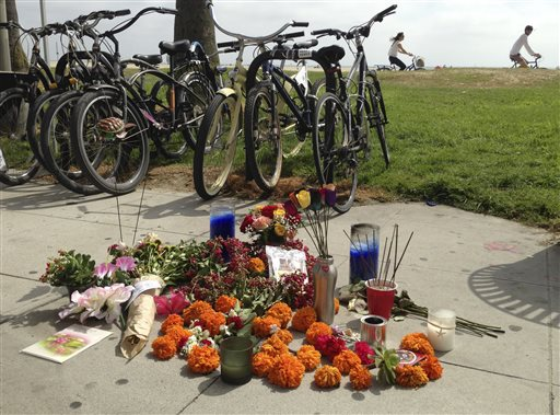 A makeshift memorial along the Venice, Calif., beach boardwalk is shown Sunday Aug. 4, 2013 near where a Saturday incident involving a driver who accelerated through a crowd of beachgoers, hitting one person after another as bystanders tried desperately to get out of the way. The hit-and-run killed an Italian woman on her honeymoon and hurt 11 others.