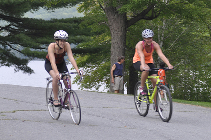 Minna Mathiasson, 22, of Cannan and Meg Hatch, 35, of Waterville in training at Lake George, In Skowhegan, for the Sept. 15 Sprint Triathlon.