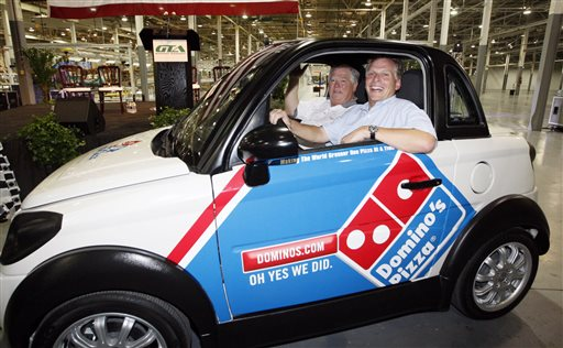 In this July 6, 2012, photograph, former Mississippi Gov. Haley Barbour, left, and then-GreenTech Automotive chairman Terry McAuliffe take a drive through the plant after the unveiling of the company's new electric MyCar in Horn Lake, Miss. Today, the place where the plant was to be remains mostly vacant except for a temporary construction trailer. The company is under investigation by the Securities and Exchange Commission.