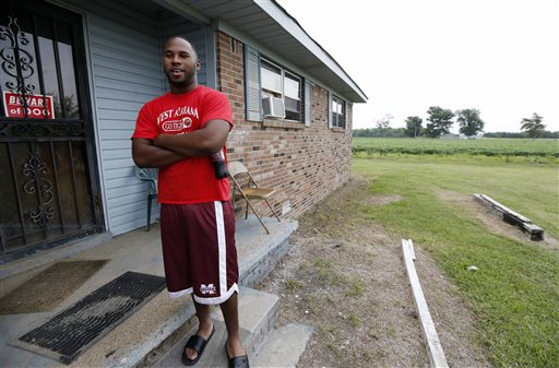 In this July 30 photograph, Perry Turner, 21, who lives across the road from the planned site for GreenTech Automotive's Tunica, Miss., assembly facility, said there was a lot of talk about the new car company years ago in the county of about 11,000 people south of Memphis, Tenn. But that talk has faded and Perry said there has been little activity at the site until recent months.