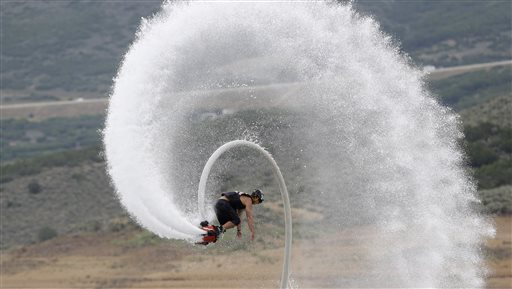 Flyboard instructor Chase Shaw flips with his flyboard, on the Jordanelle Reservoir, at Jordanelle State Park, Utah. The Flyboard, which looks like a small snowboard attached to a hose, can propel you 45 feet in the air using water pumped from a personal watercraft like a Jet Ski to the base of the board.