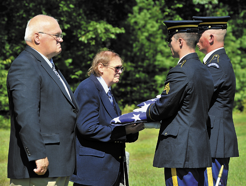 On Thursday, a Memorial was held at the Pleasant Ridge Cemetery in Hiram for four servicemen killed in past wars. Francis William Lyons, Jr. and Donald Gray, Jr. receive the folded flags from Sgt. Casey Lawrence, left, and Sgt. David Chabe of the Maine National Guard, members of the Maine Military Funeral Honors Program.