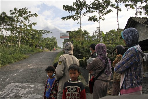 Villagers look at Merapi volcano Cangkringan, Indonesia, on Monday.