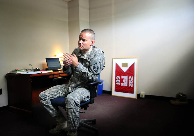 Maine Army National Guard Maj. Scott Lewis gathers his thoughts Monday at the 133rd Engineer Battalion's headquarters in Gardiner. The 45-year-old Monmouth resident will be leaving his wife and children behind to supervise hundreds of men and woman in Afghanistan for a nearly year-long deployment.