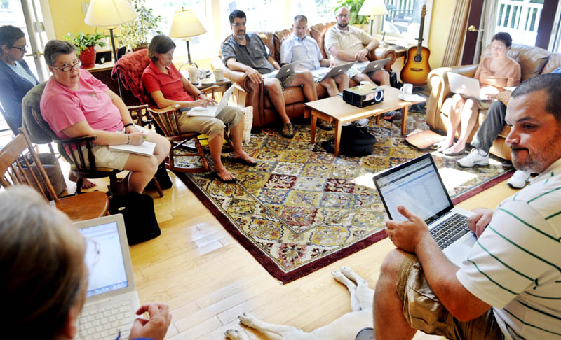 Regional School Unit 12 administrators set goals Monday for the coming school year, during a retreat at an employee's Monmouth home.