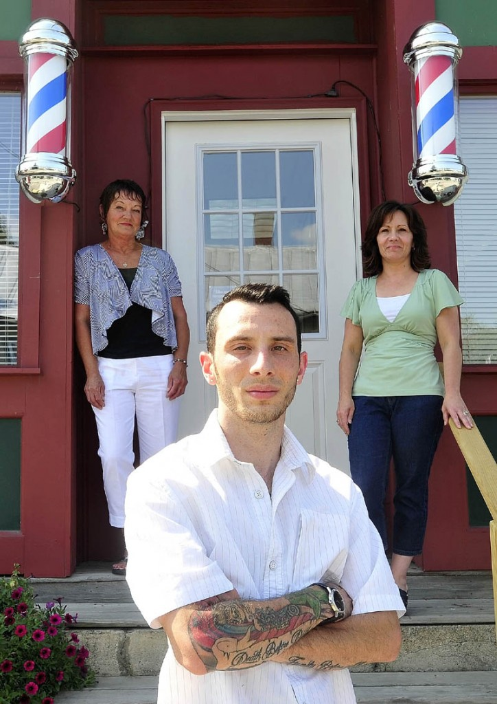 Derrik Vigue, foreground, a third-generation hair stylist in his family, poses for a portrait with his mother, Renee Vigue, back right, and grandmother, Dianne Scott, back left, both hairstylists, in front of his barber shop, Faded Lines Barber Shop, at 99 Church St. in Oakland on Thursday. Derrik recently opened his own salon and is getting expert advice and help from his mother and grandmother.