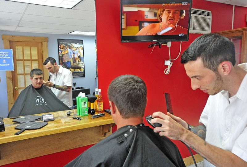 Derrik Vigue, trims the neck of Josh Gilbert, 23, of Oakland, during a cut at Faded Lines Barber Shop at 99 Church St. in Oakland on Thursday.