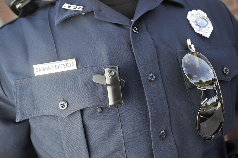 A small video camera is clipped to the right chest pocket of Waterville police officer Damon Lefferts' uniform.