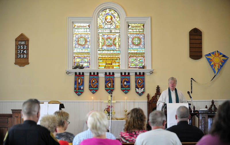 The Rev. Judy Gould speaks at Brown Memorial United Methodist Church during a service honoring police and other first responders in Clinton today.