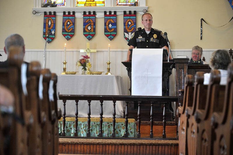 Police Chief Craig Johnson of the Clinton Police Department speaks during a service honoring police and other first responders at Brown Memorial United Methodist Church in Clinton today.