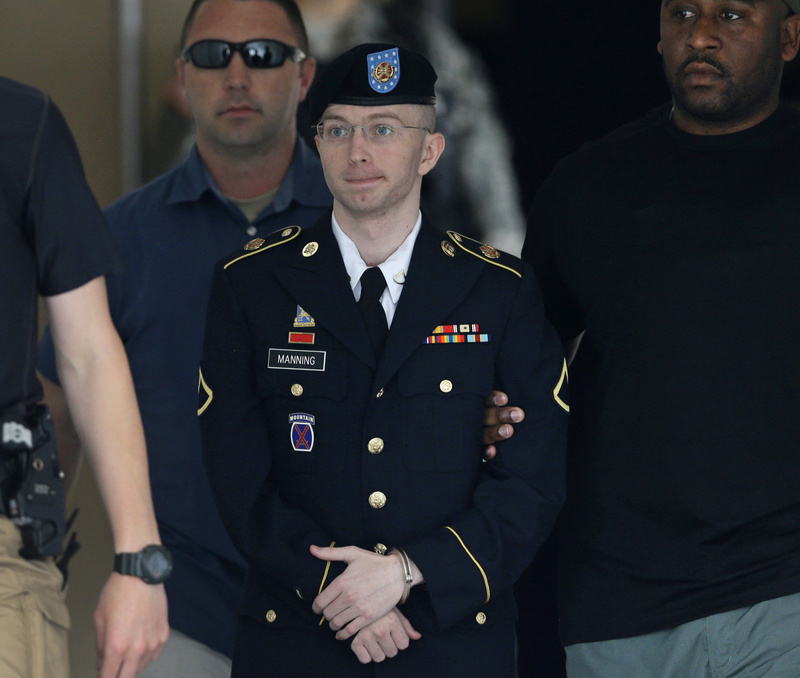 Army Pfc. Bradley Manning is escorted out of a courthouse in Fort Meade, Md., last month. He spoke at his sentencing hearing Wednesday.