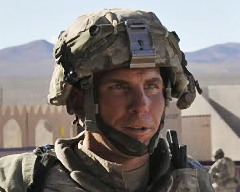 In this Aug. 23, 2011, photo, Staff Sgt. Robert Bales participates in an exercise at the National Training Center at Fort Irwin, Calif.